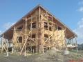 Строительство каркасно-щитового дома, обшивка фасада имитацией бруса.