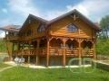 Бревенчатый дом с просторной террасой